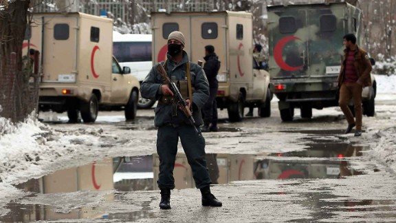 Security forces stand guard Tuesday after a suicide attack outside the Afghan Supreme Court in Kabul.