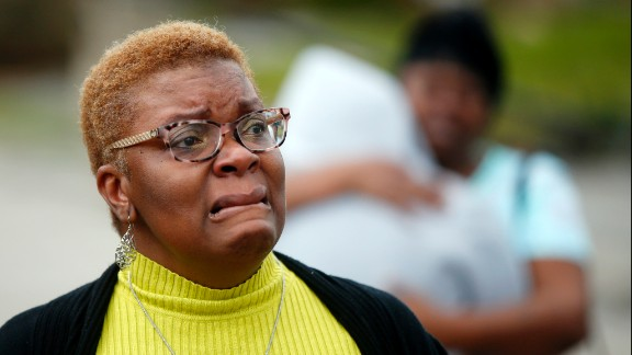 A woman reacts to the damage caused in her neighborhood.