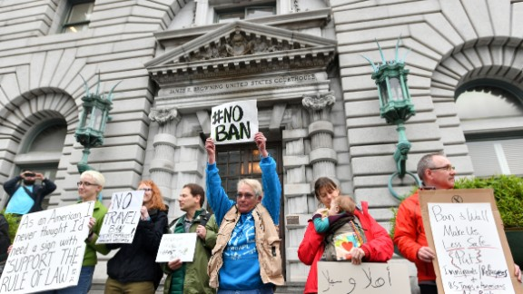 Protesters stand in front of the United States Court of Appeals for the Ninth Circuit in San Francisco, California on February 7, 2017. A federal appeals court heard arguments on Tuesday on whether to lift a nationwide suspension of President Donald Trump