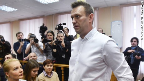 Politician Alexei Navalny, center, waits for Friday's court hearing in Kirov.