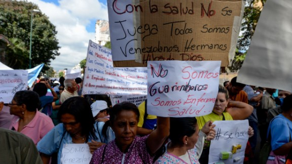 Health care workers protest over the lack of medicine and low salaries last month in Caracas.