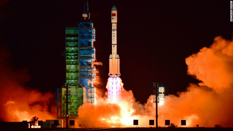 China's Tiangong 2 space lab is launched on a Long March-2F rocket from the Jiuquan Satellite Launch Center in the Gobi Desert.