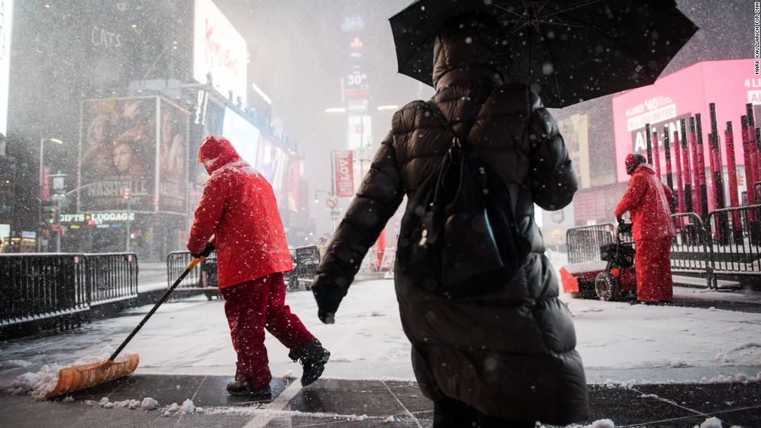 Times Square workers shovel snow on February 9.