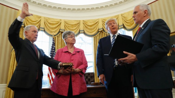 Trump watches as Pence administers the oath of office to Attorney General Jeff Sessions in the White House Oval Office on Thursday, February 9. Sessions, one of Trump