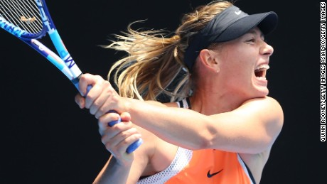 MELBOURNE, AUSTRALIA - JANUARY 26:  Maria Sharapova of Russia plays a backhand in her quarter final match against Serena Williams of the United States during day nine of the 2016 Australian Open at Melbourne Park on January 26, 2016 in Melbourne, Australia.  (Photo by Quinn Rooney/Getty Images)