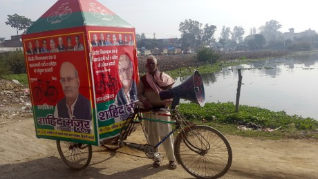 "Ahmed, 55, pulls a rickshaw promoting Yadav's party but he's not sure who he'll he vote for: ""I will cast my vote for the right person,"" he says."