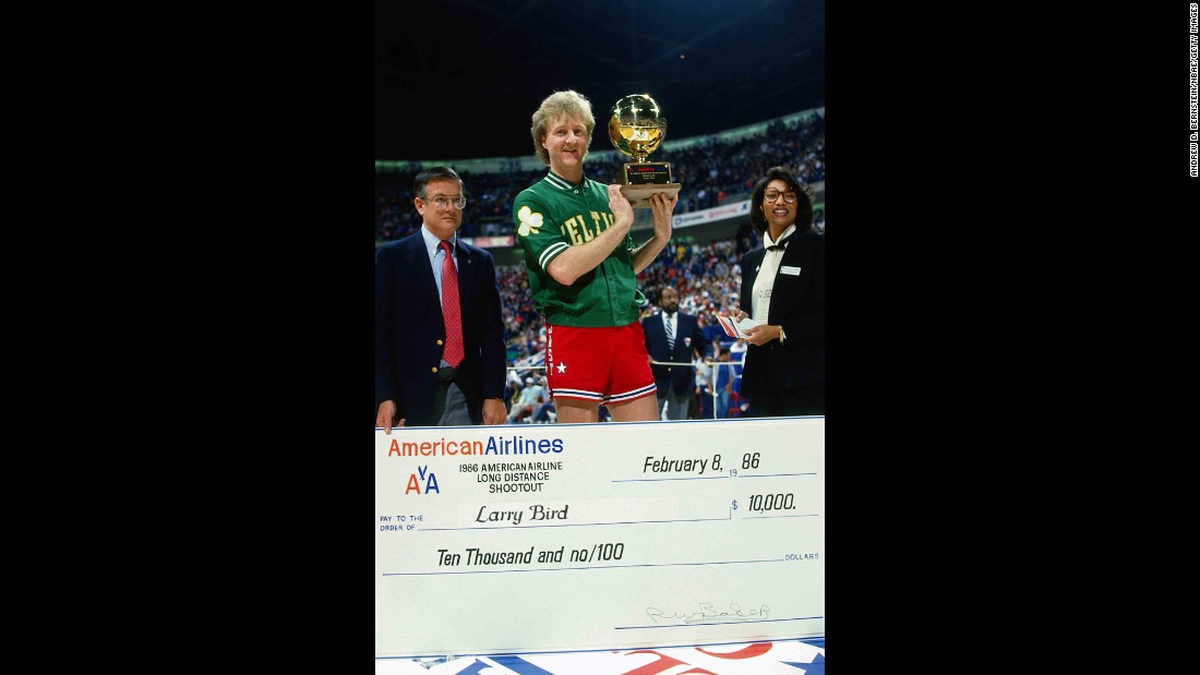 <strong>First champion:</strong> Bird receives his trophy and a check for $10,000 after winning the contest in 1986. The Boston Celtics great also won in 1997 and 1998.