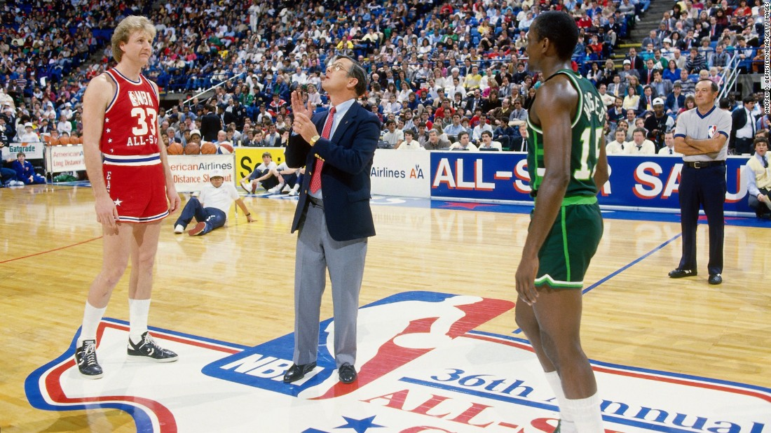 Larry Bird, left, and Craig Hodges await the outcome of a coin toss at the NBA's first 3-point shooting contest in 1986. The contest is held every year on All-Star Weekend, and the best shooters in the league compete for the title. Bird and Hodges have each won three, which is more than anyone else.