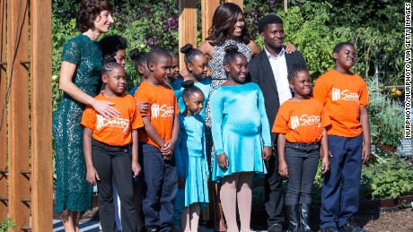 Next  to the White House Kitchen Garden on the South Lawn in Washington, DC, USA, on October 18, 2016., (l-r), Mrs. Agnese Landini, and First Lady Michelle Obama, pose for a group photo with students who performed from a local Turnaround Arts school program, as part of the spousal program for the Italy Official Visit.