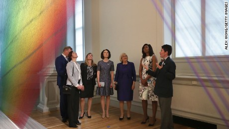 U.S. first lady Michelle Obama (6th R); Jenni Haukio (4th L), spouse of the President of Finland; Sindre Finnes (L), spouse of the Prime Minister of Norway; Ulla Lofven (5th L), spouse of the Prime Minister of Sweden; Solrun Lokke Rasmussen (3rd L), spouse of the Prime Minister of Denmark; and Ingibjorg Elsa Ingjaldsdottir (2nd L), spouse of the Prime Minister of Iceland, visit the art piece, Plexus A1, created by artist Gabriel Dawe, at the Renwick Gallery May 13, 2016 in Washington, DC.