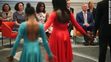 U.S. first lady Michelle Obama (3rd L); Jenni Haukio (2nd L), spouse of the President of Finland; and Sindre Finnes (2nd R), spouse of the Prime Minister of Norway, watch a dance performance during a visit at the Renwick Gallery May 13, 2016 in Washington, DC.