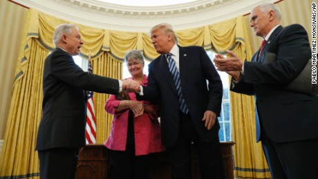 President Donald Trump shakes hands with Attorney General Jeff Sessions, accompanied by his wife Mary, after he was sworn-in by Vice President Mike Pence, right, Thursday, Feb. 9, 2017, in the Oval Office of the White House in Washington. (AP Photo/Pablo Martinez Monsivais)