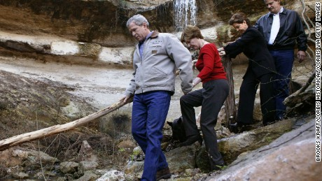 US President George W. Bush (L) holds the hand of First Lady Laura Bush as Mexican President Vicente Fox (R) and his wife Marta follow along after visiting a waterfall on Bush's ranch in Crawford. The two leaders were hoping the weekend visit might reestablish a rapport that was damaged by US irritation at Mexico for its refusal to support the Iraq war. (Photo by Brooks Kraft LLC/Corbis via Getty Images)