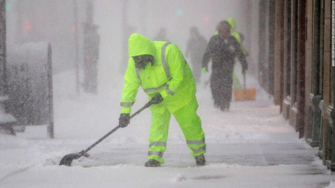 Workers clean the sidewalk on Boston's Boylston Street on February 9.