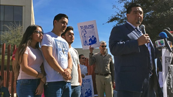 The Garcia de Rayos family stands with lawyer Ray Maldonado outside the Phoenix ICE office Thursday.