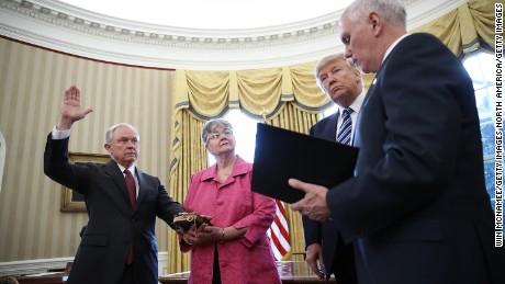 WASHINGTON, DC - FEBRUARY 09:  U.S. President Donald Trump (2nd R) watches as Jeff Sessions (L) is sworn in as the new U.S. Attorney General by U.S. Vice President Mike Pence (R) in the Oval Office of the White House February 9, 2017 in Washington, DC. Trump also signed three executive orders immediately after the swearing in ceremony. Also pictured is Sessions's wife, Mary (2nd L), holding the bible.  (Photo by Win McNamee/Getty Images)