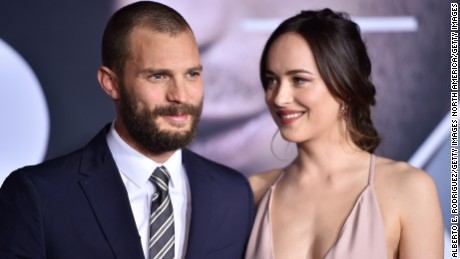 "LOS ANGELES, CA - FEBRUARY 02:  Actors Jamie Dornan and Dakota Johnson attend the premiere of Universal Pictures' ""Fifty Shades Darker"" at The Theatre at Ace Hotel on February 2, 2017 in Los Angeles, California.  (Photo by Alberto E. Rodriguez/Getty Images)"