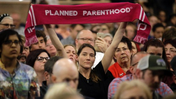 A person supporting Planned Parenthood looks on during Rep. Jason Chaffetz's town hall meeting at Brighton High School, Thursday, Feb. 9, 2017, in Cottonwood Heights, Utah. (AP Photo/Rick Bowmer)