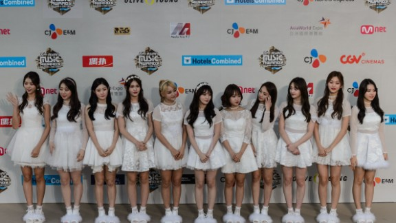 Members of I.O.I pose on the red carpet at the Mnet Asian Music Awards (MAMA) at Asia-World Expo in Hong Kong on December 2, 2016. They  disbanded on January 31, 2017.