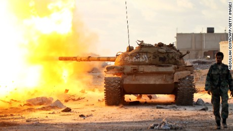 Members of the so-called Libyan National Army fire on jihadists near Benghazi in January.
