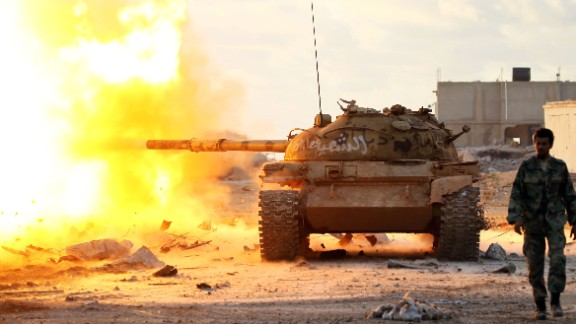Members of the Libyan National Army (LNA) fire a tank during fighting against jihadists in Qanfudah, on the southern outskirts of Benghazi, on January 14, 2017. Khalifa Haftar's forces, which call themselves the Libyan National Army (LNA), have battled jihadists in second city Benghazi for more than two years and control key eastern oil export terminals. / AFP / Abdullah DOMA        (Photo credit should read ABDULLAH DOMA/AFP/Getty Images)