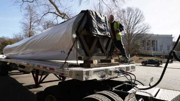 A spool holding one half of the painting prepares to leave Atlanta's Grant Park on Friday.