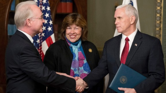 Pence shakes hands with Health and Human Services Secretary Tom Price -- who was accompanied by his wife, Betty -- after a swearing-in ceremony on Friday, February 10. Price, a former congressman from Georgia, was confirmed 52-47 in a middle-of-the-night vote along party lines.
