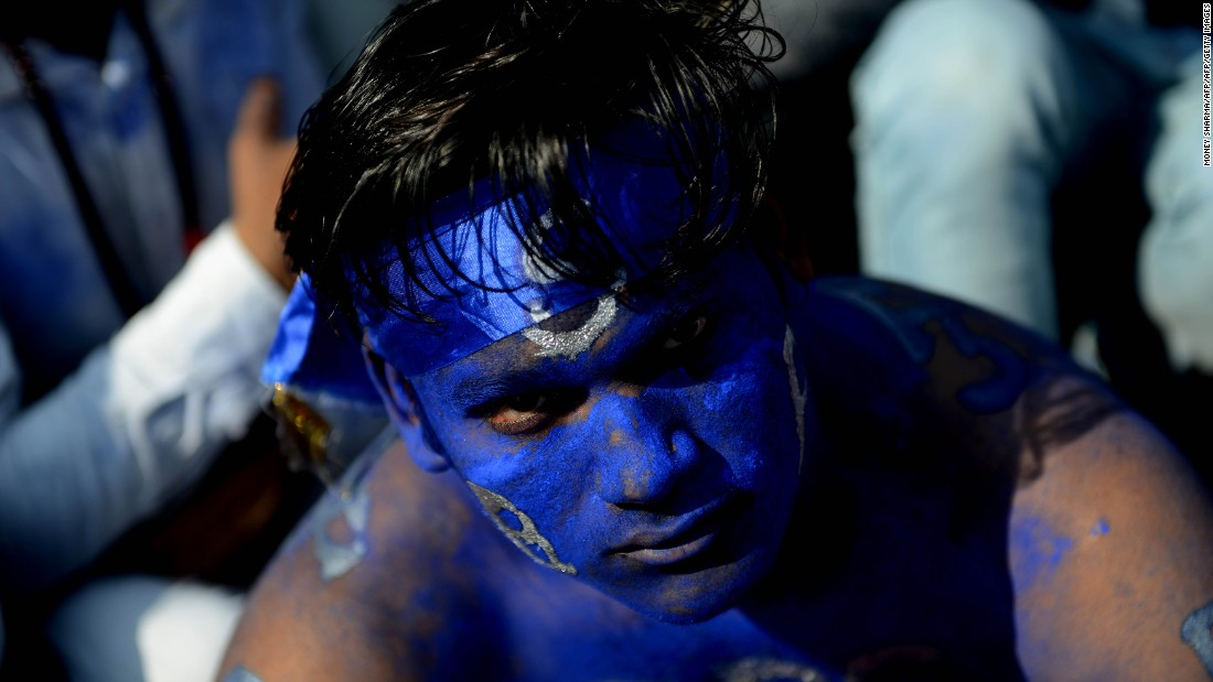 A supporter of the Bahujan Samaj Party (BSP) attends an election rally for leader Mayawati in February, 2017. Millions of voters in Uttar Pradesh, India's biggest state, start to head to the polls on February 11.