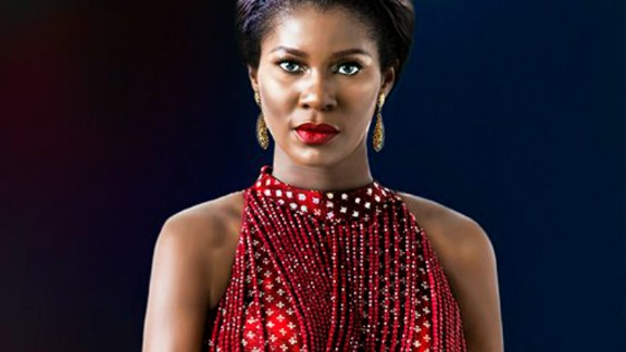 """Stephanie Okereke Linus """"has an imposing physicality,"""" explained Udé, """"yet sweet and a positively sunny personality."""" He added; """"since she has this incredibly powerful persona, I wanted to explore the possibility of a dramatic tension"""" hence the """"unexpected stretch of a leg."""""""