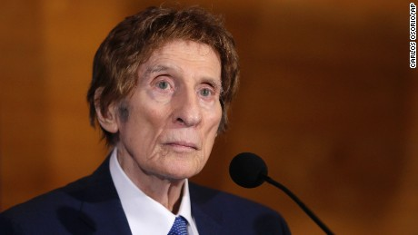 In a photo from November 14, 2014, Detroit Tigers owner Mike Ilitch listens during a news conference in Detroit. Ilitch, the owner of the Detroit Red Wings and Tigers, who founded the Little Caesars Pizza empire, has died. He was 87. Family spokesman Doug Kuiper says Ilitch died Friday, Feb. 10, 2017, at a hospital in Detroit. Ilitch and his wife opened their first Little Caesars restaurant in suburban Detroit in 1959, and the business eventually grew into the world's largest carry-out pizza chain.