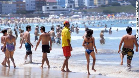 A lifeguard supervises swimmers at Sydney's Bondi Beach on Saturday, February 11.