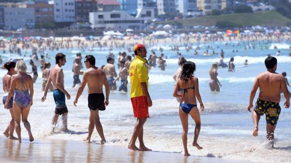A surf lifesaver supervises swimmers at Sydney's Bondi Beach on February 11, 2017. Much of Australia is experiencing a heatwave with the New South Wales weather bureau is predicting that February 11 could become the hottest February day on record for the state.
