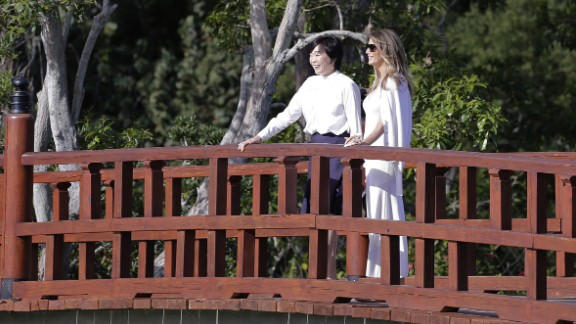 """Trump and Akie Abe, wife of Japanese Prime Minister Shinzo Abe, <a href=""""http://www.cnn.com/2017/02/11/politics/melania-trump-akie-abe-garden-tour-florida/"""" target=""""_blank"""">tour the Morikami Museum and Japanese Gardens</a> in Delray Beach, Florida, in February 2017. It was Trump's first solo public appearance as first lady."""