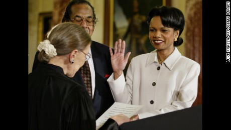 US Supreme Court Associate Justice Ruth Bader Ginsburg swears-in incoming Secretary of State Condoleezza Rice on January 2, 2005.