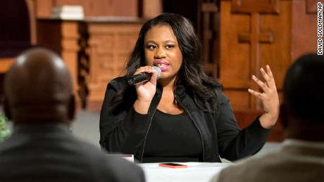 Mary-Pat Hector, right, with the National Action Network, speaks during a community town hall forum at Ebenezer Baptist Church, the church where The Rev. Martin Luther King Jr. preached, Monday, Dec. 8, 2014, in Atlanta. Dozens of people met at the church to discuss recent cases of unarmed black men being fatally shot by police and ways to improve the way officers interact with the public. (AP Photo/David Goldman)