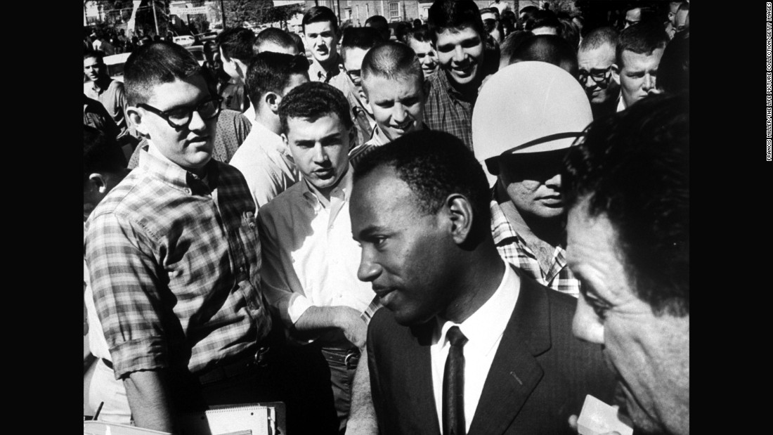 James Meredith is accompanied by two federal marshals and surrounded by jeering students after registering for entry at the <strong>University of Mississipp</strong>i in the fall of 1962. The first African-American student to enroll at the school, Meredith suffered constant harassment on campus before graduating the next year.