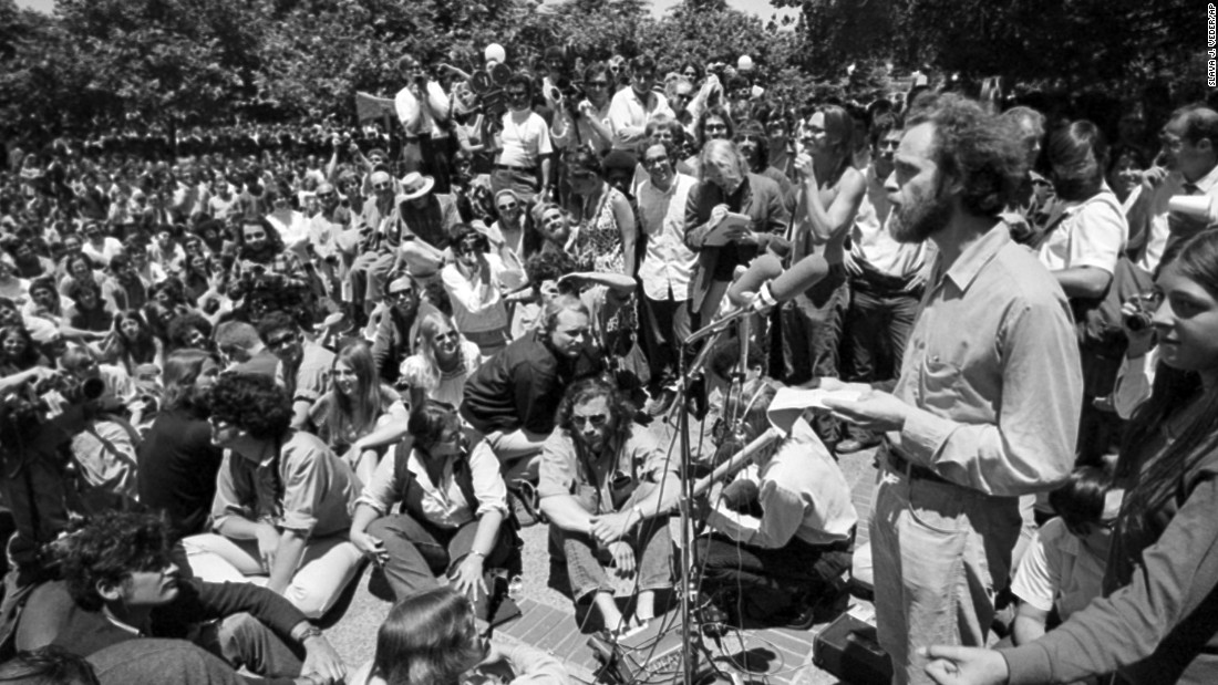 "Mario Savio, right, one of the leaders of the 1964-65 Free Speech Movement at the <strong>University of California-Berkeley</strong>, speaks at a ""Peoples Park"" rally on campus in June 1969. The movement, which protested the university's ban on student political activity, soon spread to other campuses."