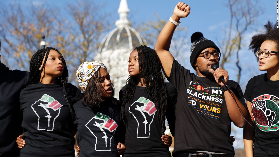 <strong>University of Missouri</strong> graduate student Jonathan Butler, second from right, speaks on November 9, 2015, following the announcement that University of Missouri System President Tim Wolfe would resign. Wolfe stepped down amid widespread protests over his handling of racial tensions at the Columbia, Missouri school.