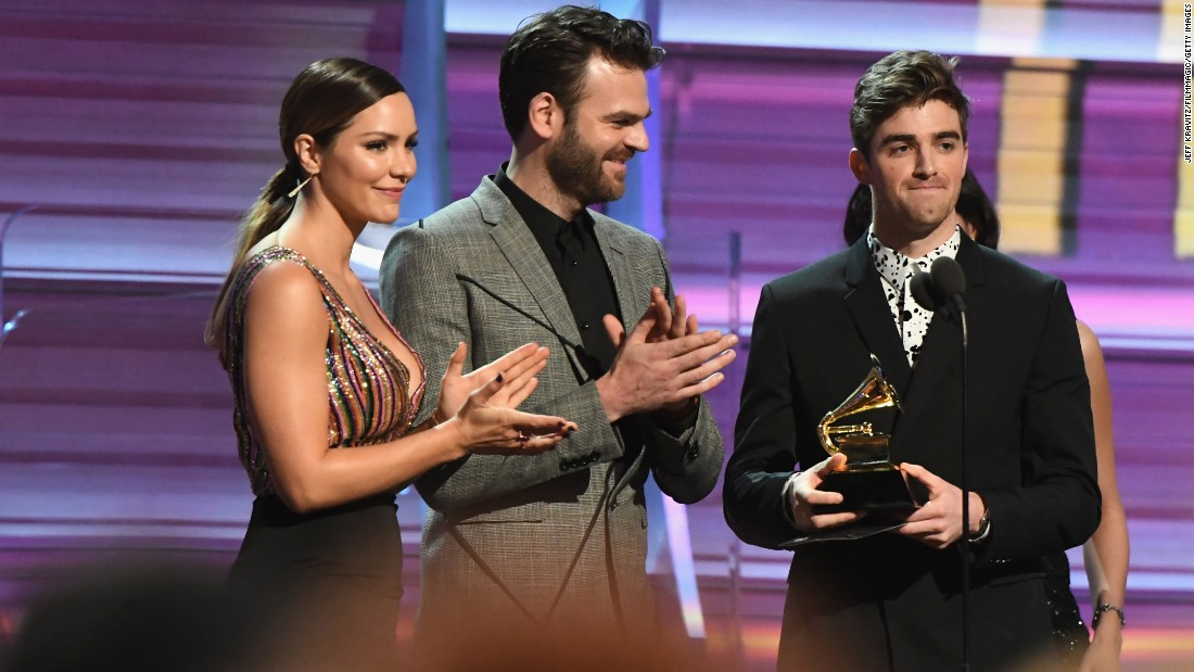 "Katharine McPhee joins Alex Pall and Andrew Taggart of The Chainsmokers as they present the Grammy for best rock song. The award went to the late David Bowie for his song ""Blackstar."""