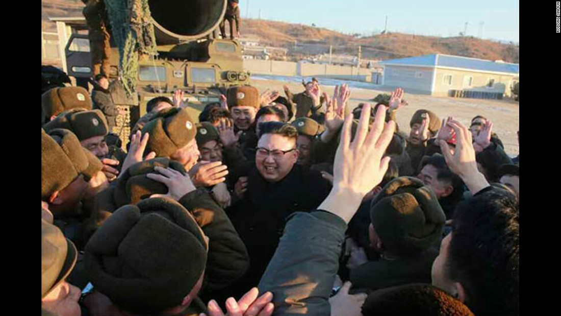 Kim celebrates with soldiers after the missile test, which North Korean state media claimed was successful.