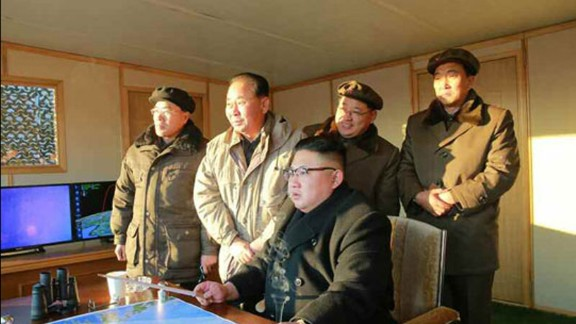 North Korean leader Kim Jong Un looks on as the country tests a new intermediate-range ballistic missile.
