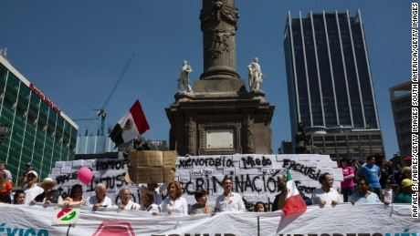 MEXICO CITY, MEXICO - FEBRUARY 12:  Demonstrators march to the Plaza Angel Independencia February 12, 2017 in Mexico City, Mexico. The marchers protested the policies of President Donald Trump and Prime Minister Enrique Pena Nieto of Mexico. (Photo by Rafael S. Fabres/Getty Images)