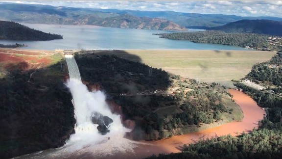 Water gushes over the primary spillway at Oroville Dam in Northern California. At least 188,000 people have been evacuated from nearby counties in recent days after erosion caused damage to two spillways and, combined with recent heavy rains, sparked fears of possible flooding.