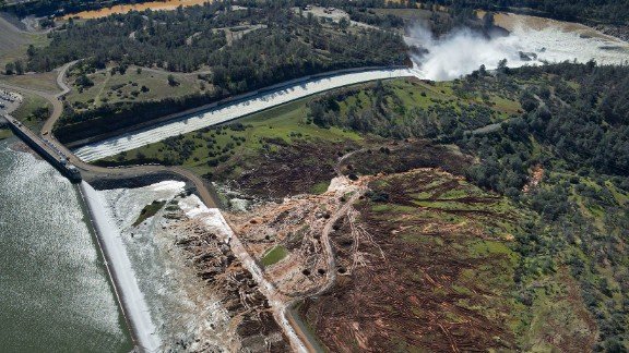 Lake water flows over the emergency spillway, bottom left, at Lake Oroville for the first time in the nearly 50-year history of the Oroville Dam Saturday, Feb. 11, 2017, in Oroville, Calif. The dam opened in 1968. (Randy Pench/The Sacramento Bee via AP)