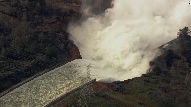 Watch water roar down Oroville Dam spillway