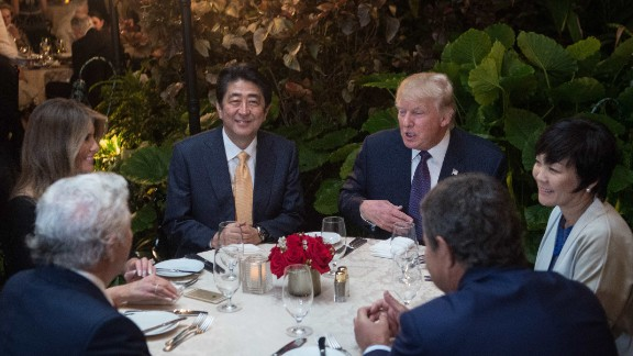 US President Donald Trump, Japanese Prime Minister Shinzo Abe (2nd-L), his wife Akie Abe (R), US First Lady Melania Trump (L) and Robert Kraft (2nd-L),owner of the New England Patriots, sit down for dinner at Trump