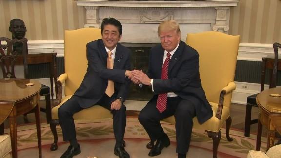 trump handshake power grab origwx bw_00000000.jpg