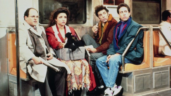 """Jason Alexander as George Costanza, Julia Louis-Dreyfus as Elaine Benes, Michael Richards as Cosmo Kramer, and Jerry Seinfeld as Jerry Seinfeld in a scene from """"Seinfeld."""""""