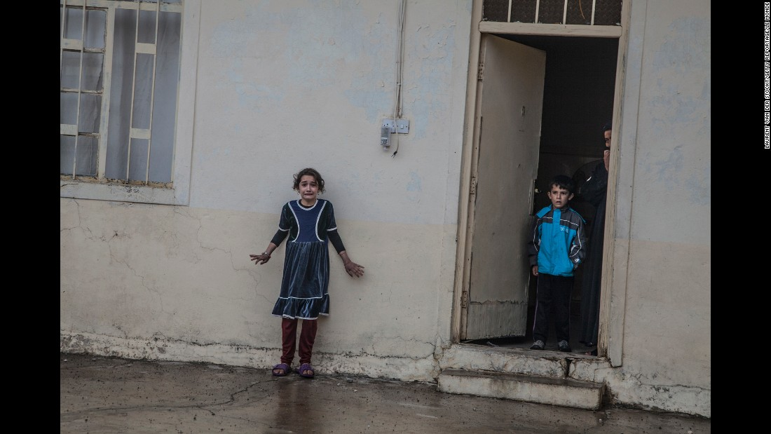 Children are photographed as Iraqi forces search a home in Mosul, Iraq, on November 2. An Iraqi-led coalition is underway to reclaim the largest region of Iraq under ISIS control.