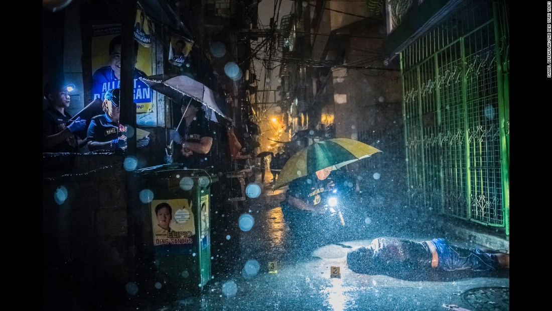 "A crime-scene investigator works near a shooting victim in Manila, Philippines, on October 11. Romeo Joel Torres Fontanilla, 37, was killed by two unidentified gunmen riding motorcycles in the early morning hours. New Philippines President Rodrigo Duterte campaigned hard on <a href=""http://www.cnn.com/2016/08/03/asia/philippines-war-on-drugs/"" target=""_blank"">a no-nonsense approach to crime,</a> and on several occasions he has hinted openly that he doesn't oppose his police force or even citizens taking the lives of suspected criminals. Critics see the approach as a complete disregard of due process."